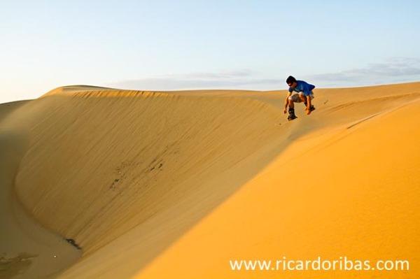 Sandboarding on the dunes of Medanos de Coro National Park, Venezuela